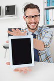 Happy casual businessman showing tablet pc