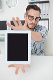 Nerdy businessman showing tablet pc screen