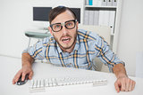 Nerdy stressed businessman working on computer