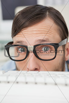 Nerdy businessman working on computer