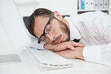 Nerdy businessman sleeping on keyboard
