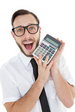 Nerdy excited businessman showing calculator
