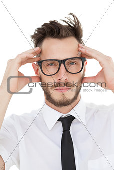 Nerdy businessman getting a headache