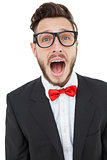 Nerdy businessman shouting with mouth open