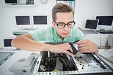 Technician working on broken computer