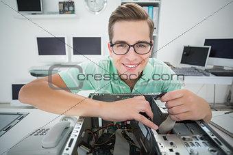 Technician working on broken computer