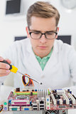 Technician working on broken cpu with screwdriver