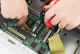 Technician working on broken cpu with soldering iron