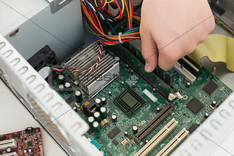 Technician working on broken cpu