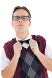 Nerdy hipster fixing his bow tie