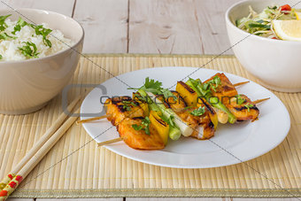 Asian tilapia filet on a skewer
