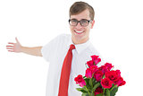 Nerdy hipster offering bouquet of roses