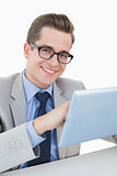 Nerdy businessman working on tablet pc