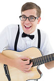 Nerdy hipster playing the guitar