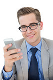 Nerdy businessman sending a text
