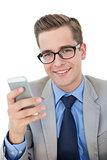 Nerdy businessman sending a text
