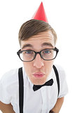 Nerdy hipster looking for a kiss in party hat
