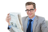 Nerdy businessman reading the newspaper