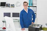 Smiling technician looking at camera