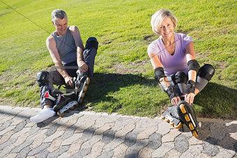Active senior couple ready to go rollerblading