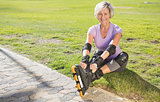 Active senior woman ready to go rollerblading