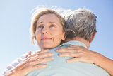 Senior woman hugging her partner