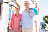 Happy senior couple shopping in the city