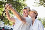 Happy senior couple posing for a selfie