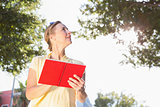 Blonde woman using her guide book