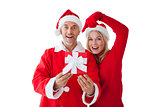 Festive couple smiling and holding gift