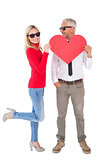 Cool couple holding a red heart together