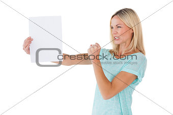 Angry woman holding piece of paper