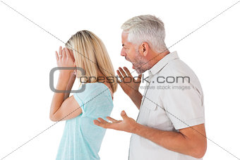 Angry man shouting at his wife