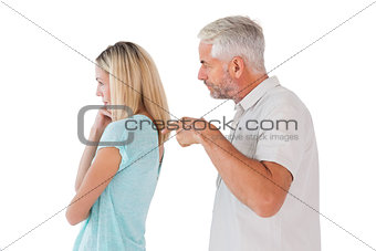 Angry man pointing at his wife