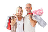 Happy couple holding shopping bags