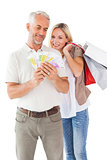 Happy couple holding shopping bags and cash
