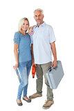 Happy couple holding DIY tools