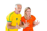 Football fan couple looking nervously ahead