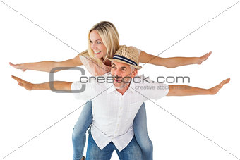 Happy man giving his partner a piggy back