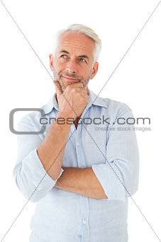Thoughtful man posing with hand on chin