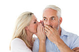 Woman whispering a secret to husband