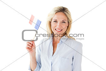 Smiling blonde woman holding french flag