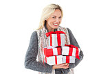 Smiling woman in winter fashion holding presents