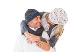 Happy couple in winter fashion embracing