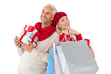 Smiling couple in winter fashion holding presents and shopping bags