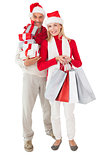 Festive couple holding presents and shopping bags