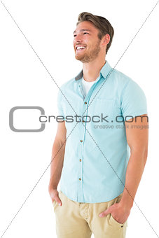 Handsome young man posing with hands in pockets