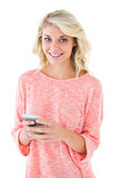 Pretty blonde using her smartphone
