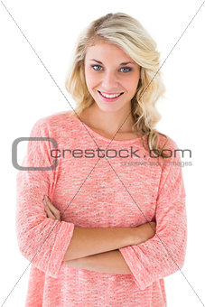 Pretty blonde smiling with arms crossed
