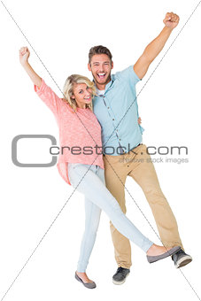 Attractive couple smiling and cheering